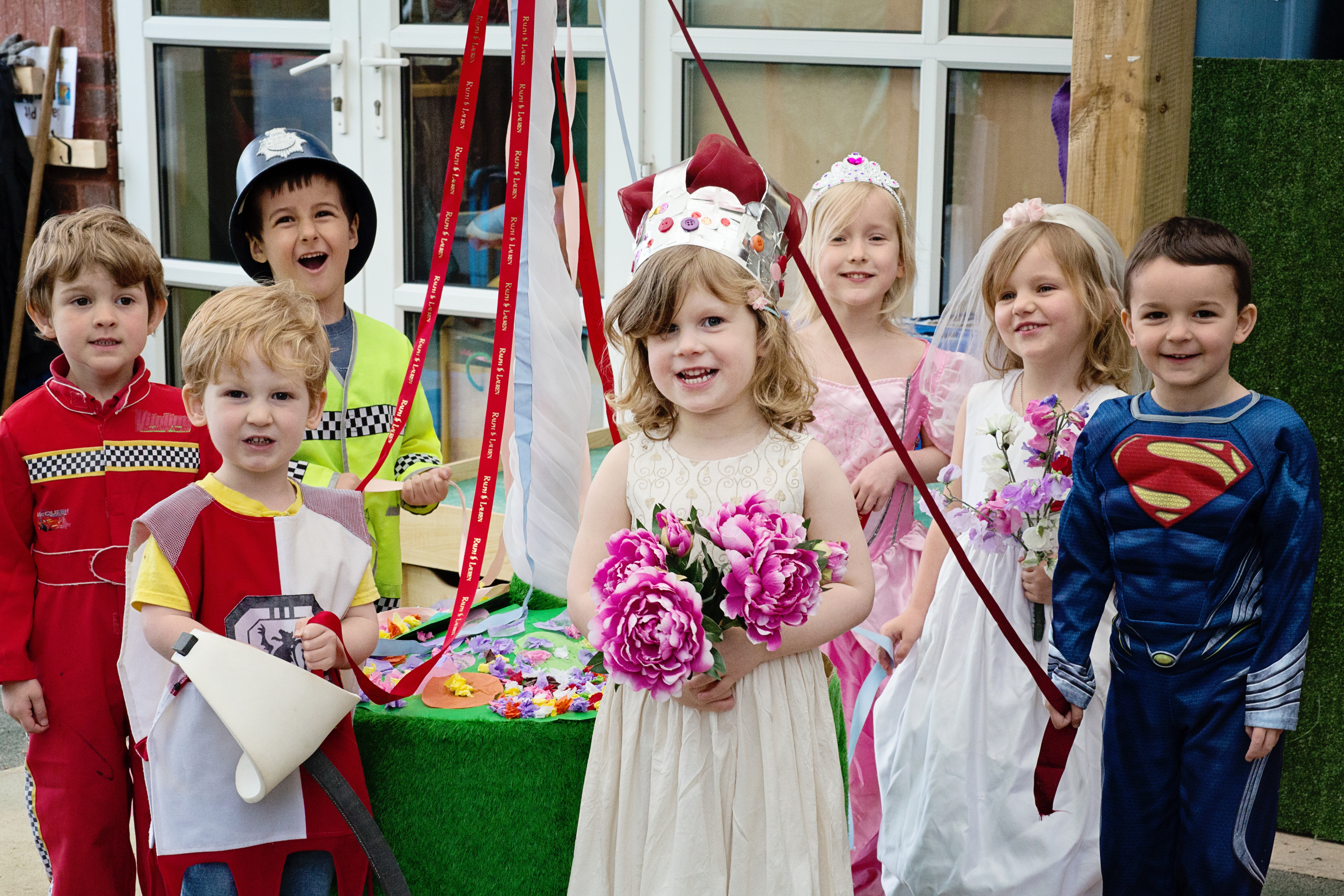 Children at Egerton Pre-School Knutsford celebrate May Day with their own procession and maypole dancing.